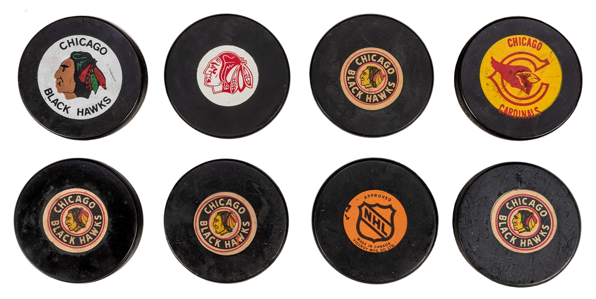 Chicago Blackhawks Vintage Hockey Pucks.
